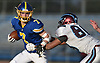 Jordan Delucia #7 of Kellenberg, left, rushes for a gain during the NYCHSFL Class AA final against Xavier (Manhattan) at Mitchel Athletic Complex in Uniondale on Saturday, Nov. 17, 2018. Kellenberg won by a score of 41-6.