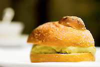 Detail of a brioche with pistachio ice cream by chef Corrado Assenza
