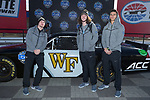 (L-R) Alex Bachman, Chase Monroe, and Sage Surratt of the Wake Forest Demon Deacons pose for a photo in front of a NASCAR race car in Victory Circle at the Charlotte Motor Speedway on December 26, 2017 in Concord, North Carolina.  (Brian Westerholt/Sports On Film)