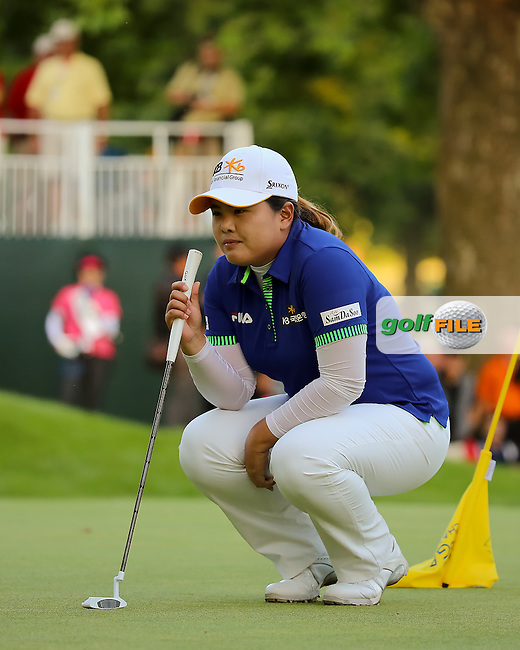 17 August 14 Korean Inbee Park looks over the winning putt on 18 at Sunday's Final Round of The Wegman's LPGA Championship at The Monroe Golf Club in Pittsford, New York. (photo credit : kenneth e. dennis/kendennisphoto.com)