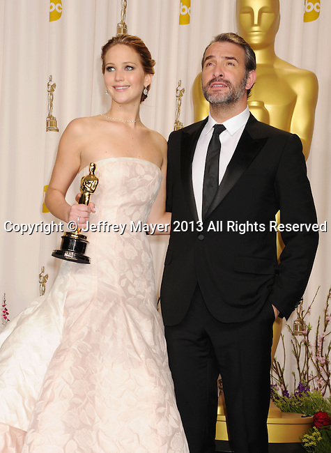 HOLLYWOOD, CA - FEBRUARY 24: Jennifer Lawrence and Jean Dujardin pose in the press room during the 85th Annual Academy Awards at the Loews Hollywood Hotel on February 24, 2013 in Hollywood, California.