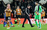 Bolton Wanderers' manager Phil Parkinson walks off dejected as Hull City's players celebrate<br /> <br /> Photographer Andrew Kearns/CameraSport<br /> <br /> The EFL Sky Bet Championship - Hull City v Bolton Wanderers - Tuesday 1st January 2019 - KC Stadium - Hull<br /> <br /> World Copyright © 2019 CameraSport. All rights reserved. 43 Linden Ave. Countesthorpe. Leicester. England. LE8 5PG - Tel: +44 (0) 116 277 4147 - admin@camerasport.com - www.camerasport.com