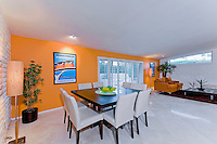Dining area of renovated mid-century Palm Springs house Stock photo of residential dining room