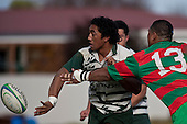 Bundellu Aki gets the backhand pass away as Sosefo Kata makes the tackle.  Counties Manukau Premier Club Rugby game between Wauku & Manurewa played at Waiuku on Saturday June 6th. Manurewa won 36 - 31 after leading 14 - 12 at halftime.
