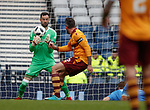 Joe Lewis lets the ball squirm through his gloves and back towards Ryan Bowman