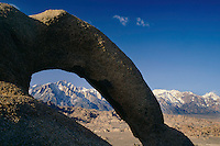 Eroded granite arch and Lone Pine Peak<br />