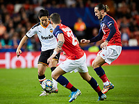 5th November 2019; Mestalla, Valencia, Spain; UEFA Champions League Football,Valencia versus Lille; Toni Lato of Valencia Kangin Lee is challenged by Domagoj Bradaric of Lille and Yusuf Yazıcı of Lille - Editorial Use