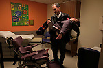 William Massart  holds his daughter Sandra Massart, 10, at Duke University Hospital in Durham, NC, USA, on Tuesday, Feb. 14, 2012.  Sandra Massart is being treated for MLD, a degenerative condition.  Photo by Ted Richardson