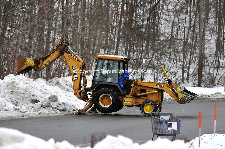 TORRINGTON, CT, 26 JAN 15 - A man uses a back-hoe to cut back snowbanks at Torrington Parkade Monday in anticipation of a blizzard.   Alec Johnson/ Republican-American