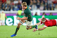 27th October 2019, Oita, Japan;  Pieter-Steph Du Toit (RSA) evades the flying tackle; 2019 Rugby World Cup Semi-final match between Wales 16-19 South Africa at International Stadium Yokohama in Yokohama, Kanagawa, Japan.
