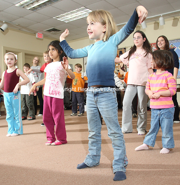 """Harwinton, CT-16 February 2008-021608MK02 (from Right) Chloe Copeland, Sasha Ahmed and Ciarra Chasse perform dance moves during a """"Hip Hop Dance Workshop"""" for children held that the Harwinton Public Library Saturday afternoon.  Over 14 children participated in the class which provided basic hip hop moves taught by Amy Fratta .Michael Kabelka / Republican-American  ( Chloe Copeland, Sasha Ahmed and Ciarra Chasse )CQ"""