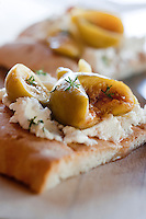 Juicy yellow poached figs served on a slice of Tuscan bread with goats cheese and thyme