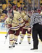 Steven Whitney (BC - 21), Isaac MacLeod (BC - 7), Barry Almeida (BC - 9) - The Boston College Eagles defeated the Northeastern University Huskies 7-1 in the opening round of the 2012 Beanpot on Monday, February 6, 2012, at TD Garden in Boston, Massachusetts.