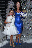 LOS ANGELES, CA - NOVEMBER 14: Caitlin Carmichael, Lisa Vanderpump, Giggy at Beverly Center Holiday Debut With Stars And Their Pets held at The Beverly Center on November 14, 2013 in Los Angeles, California. (Photo by Xavier Collin/Celebrity Monitor)