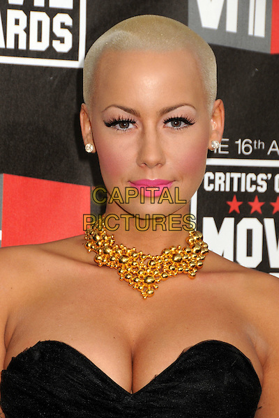 AMBER ROSE .16th Annual Critics' Choice Movie Awards held at the Hollywood Palladium, Hollywood, California, USA, 14th January 2011..portrait headshot pink lipstick make-up beauty gold necklace strapless black cleavage eyelashes .CAP/ADM/BP.©Byron Purvis/AdMedia/Capital Pictures.