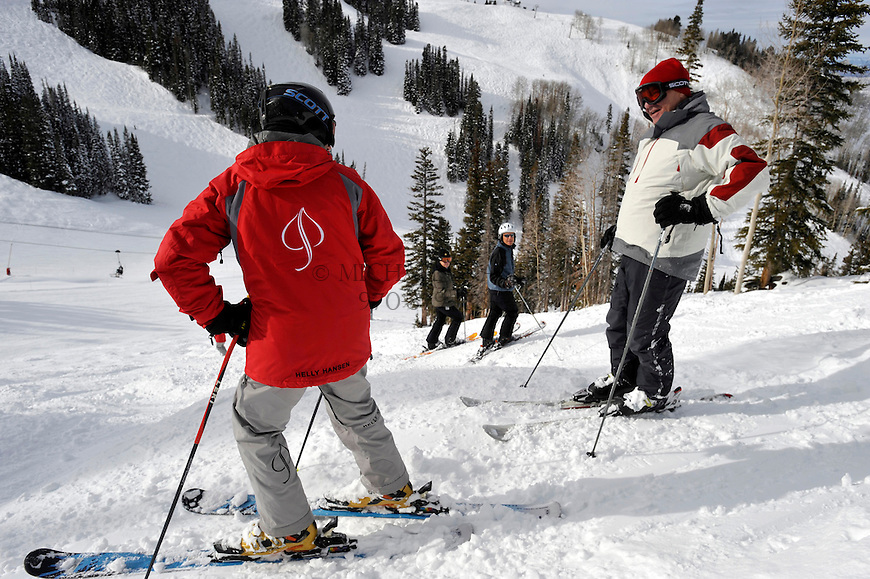 Students get feedback from instructor Alan Bush as they work their way down an intermediate mogul run on Aspen Mountain. Michael Brands for The New York Times.
