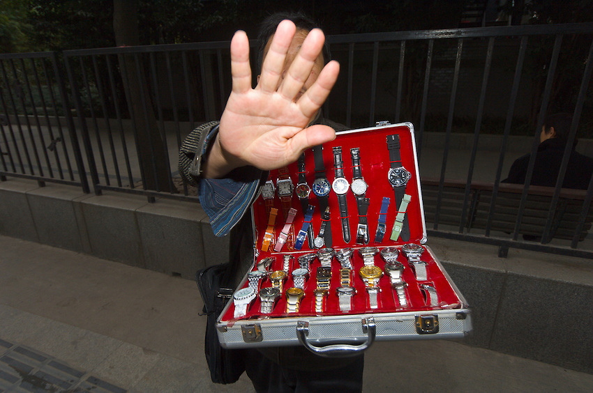 Man selling counterfeit watches, Shanghai, China
