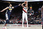 Portland Trail Blazers guard Shabazz Napier (6) shoots over Denver Nuggets guard Jamal Murray (27) in the second half at Moda Center.<br /> Photo by Jaime Valdez