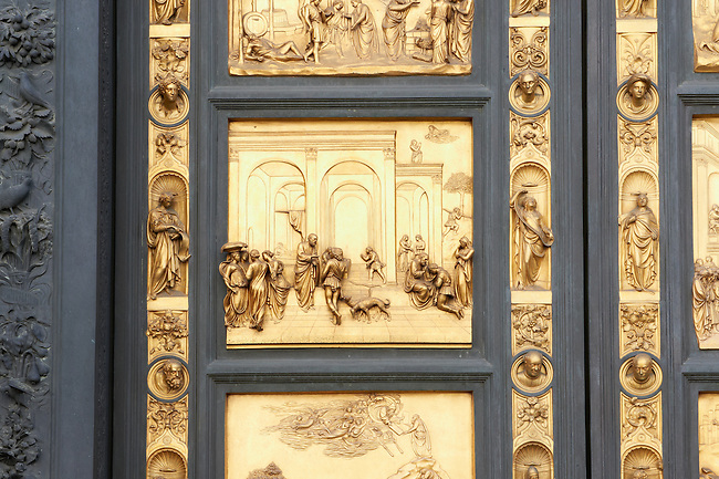 """Scenes from the early Renaissance """" Gates of Paradise"""" door of the Baptistry of Florence ( Battistero di San Giovanni ) made by Ghiberti in 1425 , made in bronze and guilded in gold. The Bapistry of the Duomo, Florence Italy"""