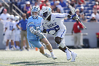 Annapolis, MD - May 20, 2018: Duke Blue Devils Nakeie Montgomery (15) runs past Johns Hopkins Blue Jays Joel Tinney (55) during the quarterfinal game between Duke vs John Hopkins at  Navy-Marine Corps Memorial Stadium in Annapolis, MD.   (Photo by Elliott Brown/Media Images International)