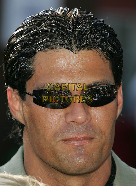 JOSE CONSECO.Paramount Pictures' World Premiere of 'The Stepford Wives' held at The Mann's Bruin Theatre in Westwood, California .June 6, 2004.headshot, portrait, sunglasses, shades.www.capitalpictures.com.sales@capitalpictures.com.©Capital Pictures