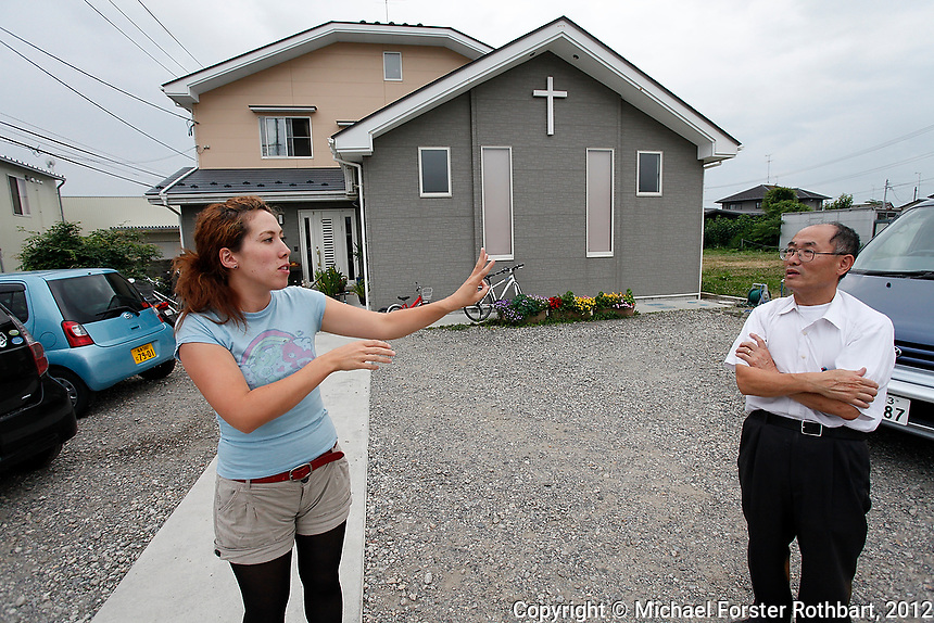 [Note: DRAFT CAPTION not to be used for publication. Some information has not been fact-checked; quotes are paraphrased from notes, awaiting direct translations. &ndash;MFR, 3/2013]<br /> <br /> Pastor Nobumasa Tajima argues with his daughter Christine about whether it was unsafe after the Fukushima Daiichi disaster to let her children play in the grass beside the church.<br /> <br /> The After Fukushima project by photojournalist Michael Forster Rothbart documents the long-term human consequences of nuclear meltdown at Japan&rsquo;s Fukushima Daiichi nuclear plant, caused by the Great East Japan Earthquake on March 11, 2011 and the tsunami that followed. <br /> &copy; Michael Forster Rothbart Photography<br /> www.mfrphoto.com &bull; 607-267-4893<br /> 34 Spruce St, Oneonta, NY 13820<br /> 86 Three Mile Pond Rd, Vassalboro, ME 04989<br /> info@mfrphoto.com<br /> Photo by: Michael Forster Rothbart<br /> Date:  7/23/2012<br /> File#:  Canon &mdash; Canon EOS 5D Mark II digital camera frame 81551