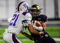 NWA Democrat-Gazette/CHARLIE KAIJO Shiloh Christian High School Micah Button (7) collides into a Arkadelphia High School defender during a Class 4A semi-final playoff football game, Saturday, December 1, 2018 at Champions Stadium at Shiloh Christian High School in Springdale.