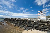 Rock wall at a fish pond on the south shore of Molokai, Hawaii