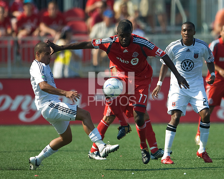 15 August 2009: D.C. United midfielder Fred #7 tangles with Toronto FC forward O'Brian White #17 during an MLS game at BMO Field in Toronto between D.C. United and Toronto FC..Toronto FC won 2-0..Photo by Nick Turchiaro/isiphotos.com.