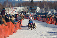 Travis Beals runs down the start chute lined with spectators during the Restart of the 2016 Iditarod in Willow, Alaska.  March 06, 2016.