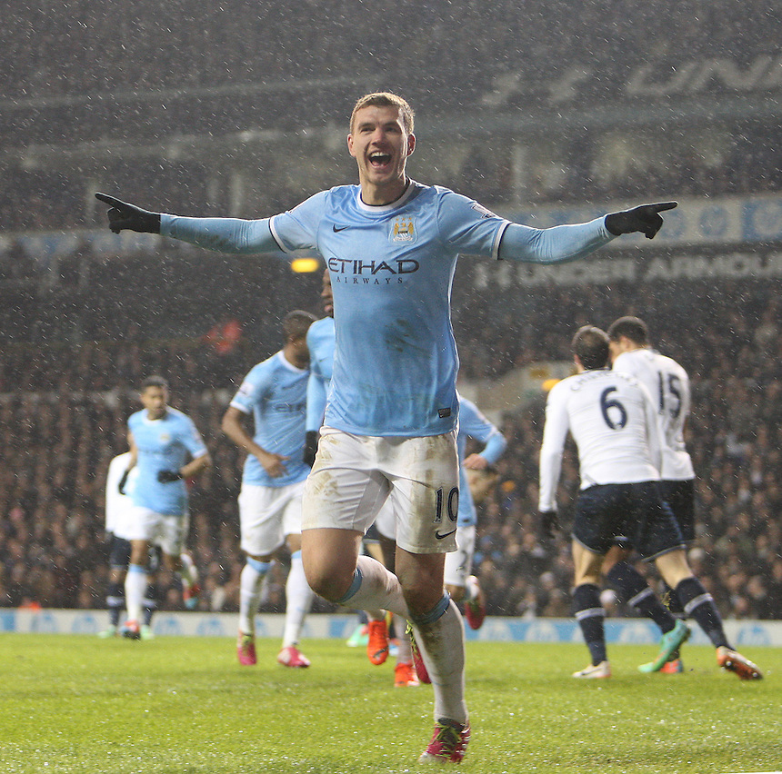 Manchester City's Edin Dzeko celebrates scoring his sides third goal <br /> Photo by Kieran Galvin/CameraSport<br /> <br /> Football - Barclays Premiership - Tottenham Hotspur v Manchester City - Wednesday 29th january 2014 - White Hart Lane - London<br /> <br /> &copy; CameraSport - 43 Linden Ave. Countesthorpe. Leicester. England. LE8 5PG - Tel: +44 (0) 116 277 4147 - admin@camerasport.com - www.camerasport.com