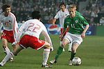 Dublin Ireland, Ireland's No 11 Damien Duff weiving his way by China's No 22 Hu Zhaniun during the friendly international soccer match in Lansdowne Road, Stadium, Dublin, Irelande, 29/3/05.Photo AFP/NEWSFILE/FRAN CAFFREY..(Photo credit should read  AFP Photo FRAN CAFFREY/NEWSFILE)...This Picture has been sent you under the condtions enclosed by:.Newsfile Ltd..the Studio,.Millmount Abbey,.Drogheda,.Co Meath..Ireland..Tel: +353(0)41-9871240.Fax: +353(0)41-9871260.GSM: +353(0)86-2500958.email: pictures@newsfile.ie.www.newsfile.ie.FTP: 193.120.102.198..This picture is from Fran Caffrey@newsfile.ie