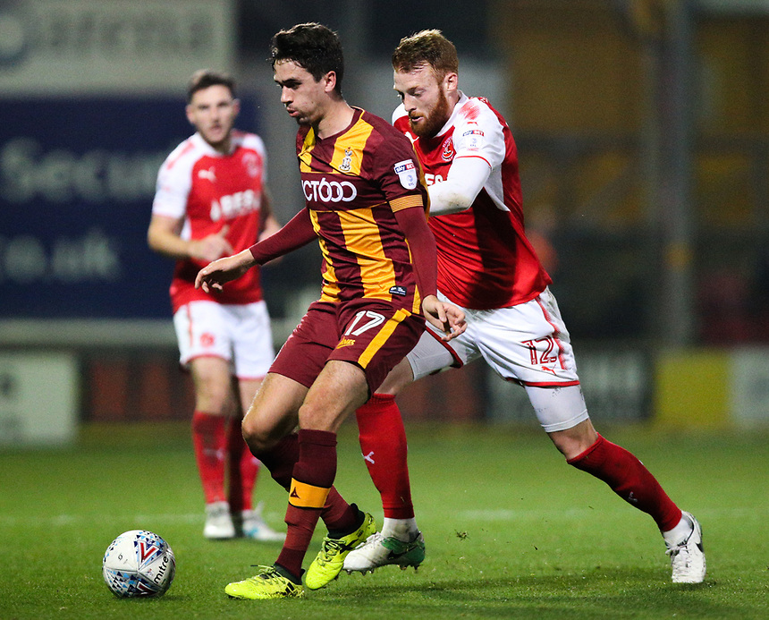 Bradford City's Alex Gilliead holds off the challenge from Fleetwood Town's Cian Bolger<br /> <br /> Photographer Alex Dodd/CameraSport<br /> <br /> The EFL Sky Bet League One - Bradford City v Fleetwood Town - Tuesday 26th September 2017 - Valley Parade - Bradford<br /> <br /> World Copyright &copy; 2017 CameraSport. All rights reserved. 43 Linden Ave. Countesthorpe. Leicester. England. LE8 5PG - Tel: +44 (0) 116 277 4147 - admin@camerasport.com - www.camerasport.com
