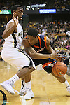202 23 January 2010: In game action at Joel Coliseum Winston Salem North Carolina as Virginia's Jontel Evans tries to drive past Wake Forest guard Ishmael Smith. Wake would hand the Cavs their first ACC loss 69-57..Mandatory Credit:Jim Dedmon/ Southcreek Global, Virginia 57 at Wake 69