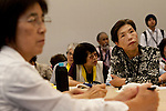 Women Protesters listen as anti-nuclear activists and female lawmakers and speak in the  Member's Office Building of the House of Councillors in Tokyo, Japan. Friday June 29th 2012.  400 protesters campaigned the restarting of the Oi nuclear power-station and the policy of Prime-Minister Noda to restart Japan's nuclear power generation programme which has been stalled since the earthquake and tsunami of March 11th 2011 caused meltdown and radiation leaks at the Fukushima Daichi Nuclear power-plant.