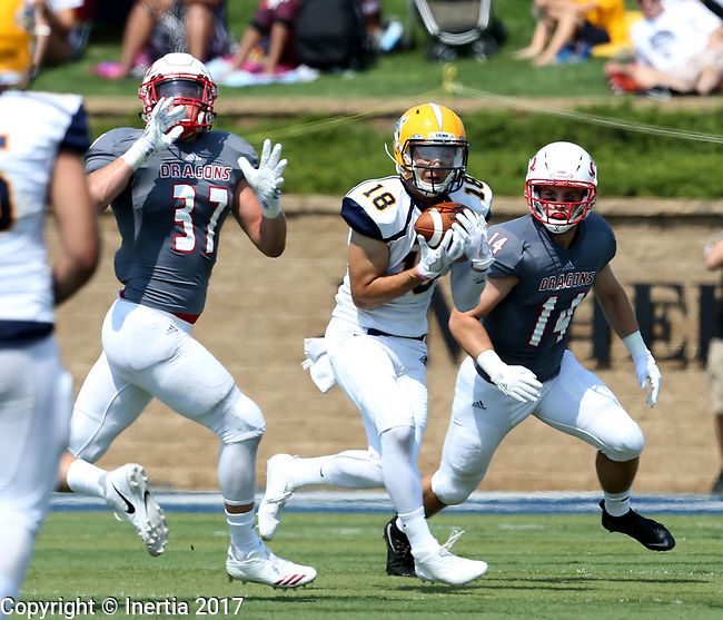 SIOUX FALLS, SD - SEPTEMBER 2: Matt Fujinami #18 from Augustana hauls in the ball in front of Casey Paskey #37 and Michael Strand #14 from the University of Minnesota Morehead in the first half of their game Saturday afternoon at Augustana University. (Photo by Dave Eggen/Inertia)