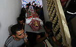 Relatives of Palestinian Naji Ghneim, 23, who died of his wounds endured during clashes with Israeli troops in a tent city protest where Palestinians demand the right to return to their homeland at the Israel-Gaza border, mourn during his funeral in Rafah in the southern Gaza strip, on May 30, 2018. Photo by Ashraf Amra