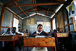 Primary students take their 5th grade midterms at the Red Soil School in Ngong, Kenya.