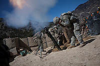 US Army Soldiers from Viper Company 126, 2nd Platoon, fire 120mm high explosive mortars in support of attacks on Restrepo Firebase from Korengal Outpost in the restive Korengal Valley. Restrepo, a remote outpost, is known as one of the most violent places in Afghanistan. Located in the Korengal Valley it comes under fire on a daily basis from Anti-Afghan Forces in the local villages and mountains.