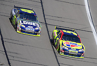 Sept. 28, 2008; Kansas City, KS, USA; Nascar Sprint Cup Series driver Casey Mears 95) leads teammate Jimmie Johnson (48) during the Camping World RV 400 at Kansas Speedway. Mandatory Credit: Mark J. Rebilas-