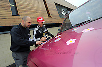 """Pictured L-R: Leigh Evans and Jonathan de Guzman with the Suzuki Samurai at the Landore Training Ground. Saturday 10 May 2014<br /> Re: Leigh Evans of Leigh Enterprise Tyres is the new owner of """"the pink Ferrari"""", an old Suzuki Samurai 4x4 car used by Swansea City FC players during the last season."""