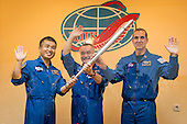 Expedition 38 Flight Engineer Koichi Wakata of the Japan Aerospace Exploration Agency, left, Soyuz Commander Mikhail Tyurin of Roscosmos, and, Flight Engineer Rick Mastracchio of NASA, right, smile and was as they hold an Olympic torch that will be flown with them to the International Space Station, during a press conference held Wednesday, Nov. 6, 2013, at the Cosmonaut hotel in Baikonur, Kazakhstan.  Launch of the Soyuz rocket is scheduled for November 7 and will send Tyurin, Mastracchio, Wakata on a six-month mission aboard the International Space Station. <br /> Mandatory Credit: Bill Ingalls / NASA via CNP