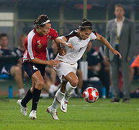USWNT midfielder (11) Carli Lloyd fights for the ball with Norwegian midfielder (4) Ingvild Stensland during first round play for the 2008 Beijing Olympics in Qinhuangdao, China. .  The US lost to Norway, 2-0, at Qinhuangdao Stadium.
