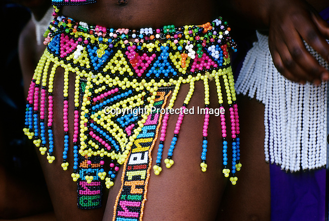 An unidentified maiden wears a traditional Zulu skirt as she's preparing for the annual Reed Dance on September 11, 2004 in Nongoma in rural Natal, South Africa. About 20.000 fellow maidens from all over South Africa arrived to dance for Zulu King Goodwill Zwelethini at the Enyokeni Royal Palace in Kwa-Nongoma about 350 kilometers from Durban. The girls come to the kingdom to declare their virginity and the ceremony encourages girls and young women to abstain from sexual activity. (Photo by: Per-Anders Pettersson)
