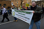 "Several pro-gun activists, including these men carrying a banner favoring open carry laws, showed up for a January 13, 2013, rally in Seattle calling for stricter regulations of firearms. Sponsored by a network of churches and other groups called ""Stand-up Washington,"" the demonstrators called for a state ban on semi-automatic weapons as well as stricter gun laws. The presence of pro-gun activists provoked heated discussions, but none of them shot anyone during the event."