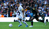 Leeds United's Ezgjan Alioski battles with Swansea City's Andre Ayew<br /> <br /> Photographer Alex Dodd/CameraSport<br /> <br /> The EFL Sky Bet Championship - Leeds United v Swansea City - Saturday 31st August 2019 - Elland Road - Leeds<br /> <br /> World Copyright © 2019 CameraSport. All rights reserved. 43 Linden Ave. Countesthorpe. Leicester. England. LE8 5PG - Tel: +44 (0) 116 277 4147 - admin@camerasport.com - www.camerasport.com