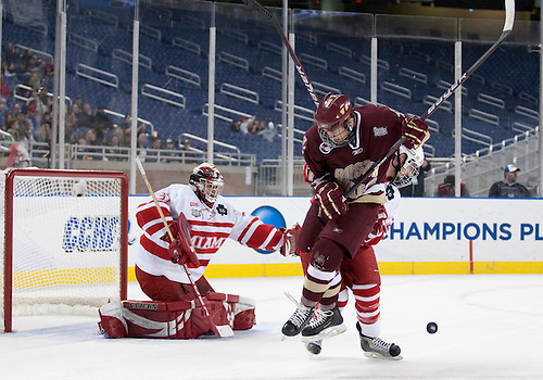 08 April 2010: Boston College Forward Pat Mullane (#11) jumps to screen Miami Goaltender Connor Knapp (#31) in game action between the Miami (Ohio) Redhawks and the Boston College Eagles at Ford Field in Detroit, Michigan. Boston College defeated Miami 7-1. Mandatory Credit: John Mersits / Southcreek Global