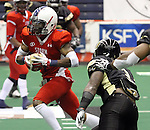 SIOUX FALLS, SD - JUNE 23:  Carl Sims #4 from the Sioux Falls Storm makes a move against Marvin Johnson #3 from the Lee Valley Steelhawks in the second quarter of their first round playoff game Saturday night at the Sioux Falls Arena. (Photo by Dave Eggen/Inertia)