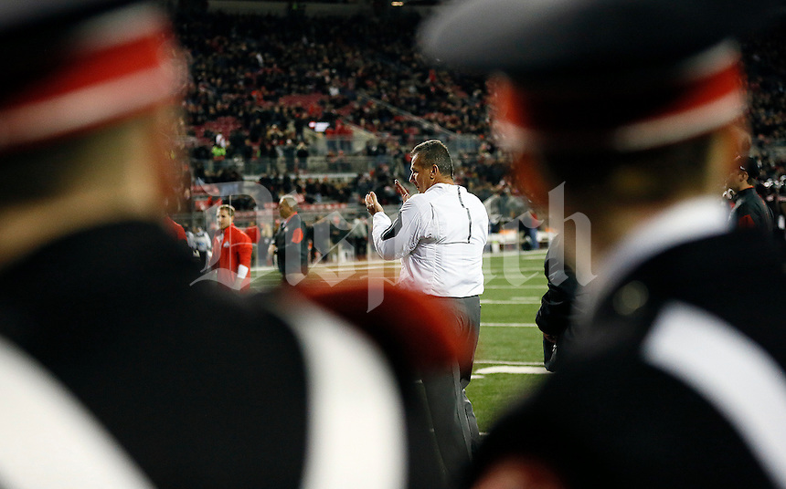 Ohio State Buckeyes head coach Urban Meyer watches his team do the quick cals drill prior to the NCAA football game against the Penn State Nittany Lions at Ohio Stadium in Columbus on Oct. 17, 2015. (Adam Cairns / The Columbus Dispatch)