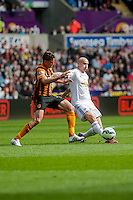 SWANSEA, WALES - APRIL 04: Jonjo Shelvey of Swansea City  in action  during the Premier League match between Swansea City and Hull City at Liberty Stadium on April 04, 2015 in Swansea, Wales.  (photo by Athena Pictures)